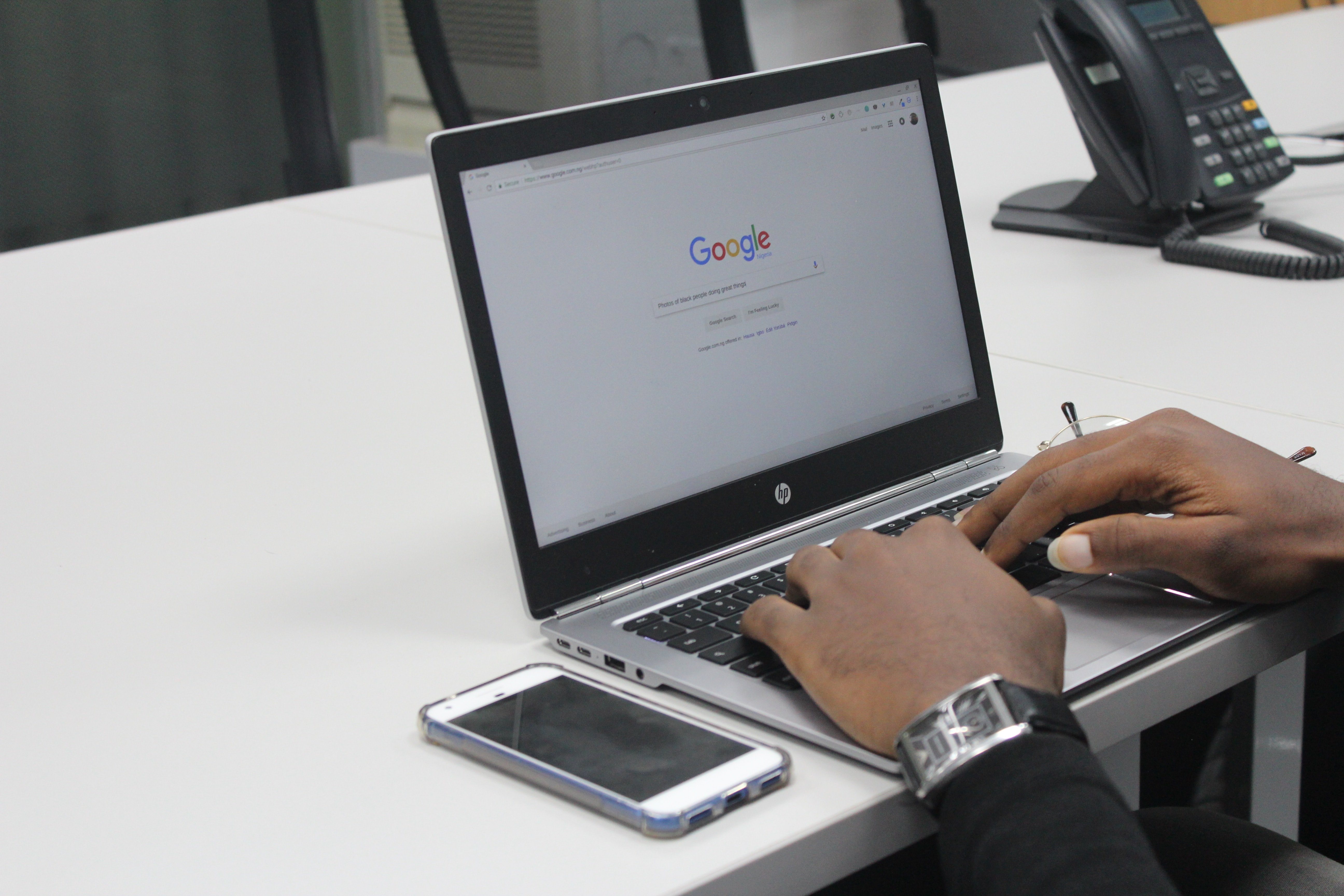 Man typing query on Google